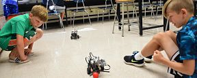 A small but enthusiastic group of students were immersed in robotics at Massapequa High School from